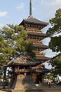 Temple number 75. The birthplace of Kobo Daishi and the largest temple complex in Shikoku with seven shrines and a pagoda. <br /> <br /> <br /> Fem v&aring;ningar h&ouml;g pagoda vid tempel nummer 75 Zentsū-ji. <br /> <br /> Pilgrimsvandring till 88 tempel p&aring; japanska &ouml;n Shikoku till minne av den japanske munken Kūkai (Kōbō Daishi). <br /> <br /> Fotograf: Christina Sj&ouml;gren<br /> Copyright 2018, All Rights Reserved