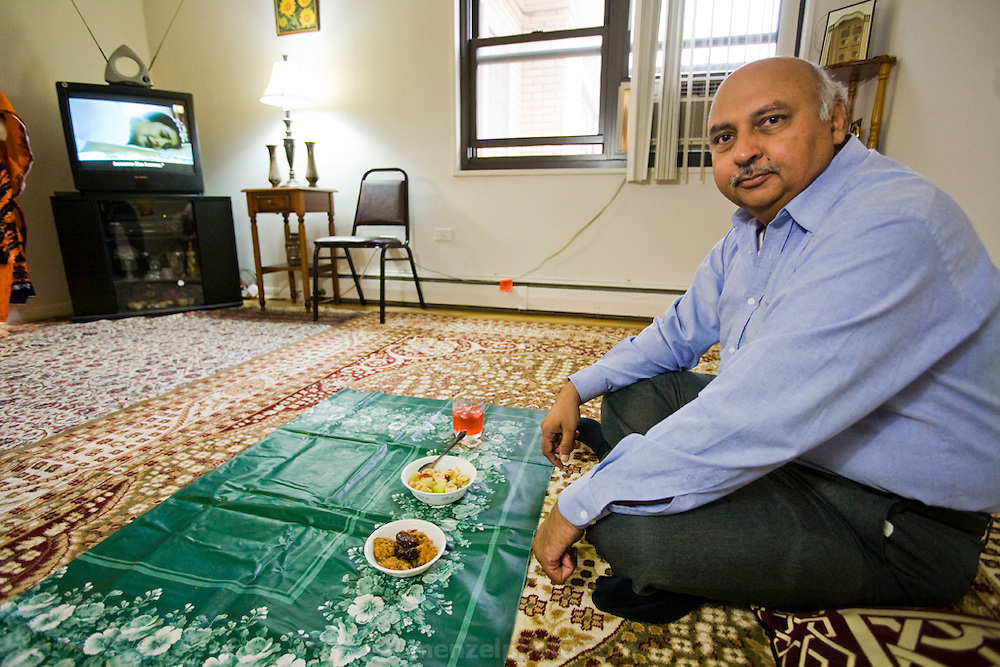 Din Memon, a Chicago taxi driver at his home in Chicago, Illinois. (Din Memon is featured in the book What I Eat: Around the World in 80 Diets.) MODEL RELEASED.