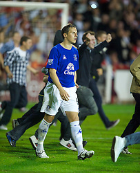 BRENTFORD, ENGLAND - Tuesday, September 21, 2010: Everton's Phil Jagielka looks dejected after his penalty is saved during the penalty shoot-out during the Football League Cup 3rd Round match against Brentford at Griffin Park. (Photo by David Rawcliffe/Propaganda)