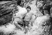 This scout get a cold shower in a stream on the Mountain Sea Trail in the Pisgah National Forest.