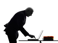 One Caucasian Senior Business Man computing laptop typing Silhouette White Background