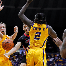 February 22, 2012; Baton Rouge, LA; Georgia Bulldogs forward Nemanja Djurisic (42) defended by LSU Tigers forward Johnny O'Bryant (2) and center Justin Hamilton (41) passes to Bulldogs forward Donte Williams (15) during the second half of a game at the Pete Maravich Assembly Center. LSU defeated Georgia 61-53. Mandatory Credit: Derick E. Hingle-US PRESSWIRE
