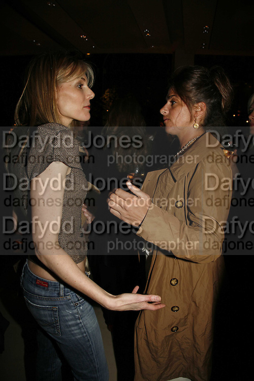 KIM HERSOV AND TRACEY EMIN. Champagne reception celebrating 100 years of Chinese cinema  hosted by Hamish McAlpine of Tartan Films, Raising money for Care For Children, a foster care programme in China. Aspreys. New Bond St. London. 25 April 2006. ONE TIME USE ONLY - DO NOT ARCHIVE  © Copyright Photograph by Dafydd Jones 66 Stockwell Park Rd. London SW9 0DA Tel 020 7733 0108 www.dafjones.com