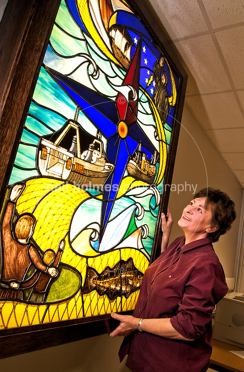 Stained Glass Artist Valerie Green of the The Stained Glass Centre Killerby Lane, Cayton. Valerie is seen here with the window she created for Hull Fish Auction 'Fishgate' seen here on March 19, 2002