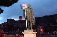 """Roma 5 Giugno 2008.  <br /> L' Associazione ambientalista  """"Terra""""  per protesta contro l'emissione di CO2, ha applicato  su 150 statue di Roma  mascherine antinquinamento e cartelli contro il CO2.La Statua di Giulio Cesare ai Fori Imperiali<br /> Rome June 5, 2008.  <br /> L 'Environmental association """"Earth"""" in protest against the emission of CO2, has applied to 150 statues of Rome anti-pollution masks and poster against the CO2."""