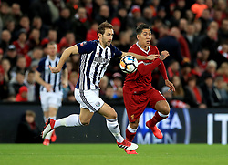 West Bromwich Albion's Craig Dawson (left) and Liverpool's Roberto Firmino battle for the ball during the Emirates FA Cup, fourth round match at Anfield, Liverpool.