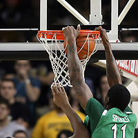 Marshall center Nigel Spikes (11) slam dunks the ball during a Conference USA NCAA basketball game between the Marshall Thundering Herd and the Central Florida Knights at the UCF Arena on January 5, 2011 in Orlando, Florida. Central Florida won the game 65-58 and extended their record to 14-0.  (AP Photo/Alex Menendez)