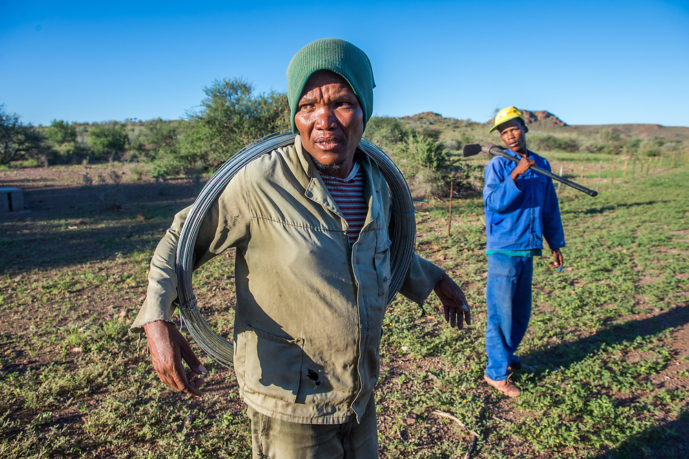 Farm workers rest for a short moment on Dabis Guest Farm in Helmeringhausen, southern Namibia, Africa.