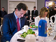 21 FEBRUARY 2012 - PHOENIX, AZ:  Former Senator and Republican Presidential candidate RICK SANTORUM accompanied by his wife, KAREN SANTORUM, bow their heads in prayer before eating at the Maricopa County Lincoln Day lunch in Phoenix. Santorum was in Phoenix Tuesday for an Arizona Republican party leadership luncheon ahead of the state's Republican Presidential Primary election and a CNN Republican Presidential Primary debate, which is Wednesday, Feb. 22.  PHOTO BY JACK KURTZ
