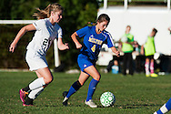 Milton's Kaleigh Goulette (4) runs past Rice's Stephanie Langlais (25) with the ball during the girls soccer game between the Milton Yellowjackets and the Rice Green Knights at Rice Memorial High School on Saturday afternoon October 3, 2015 in South Burlington. (BRIAN JENKINS/ for the FREE PRESS)