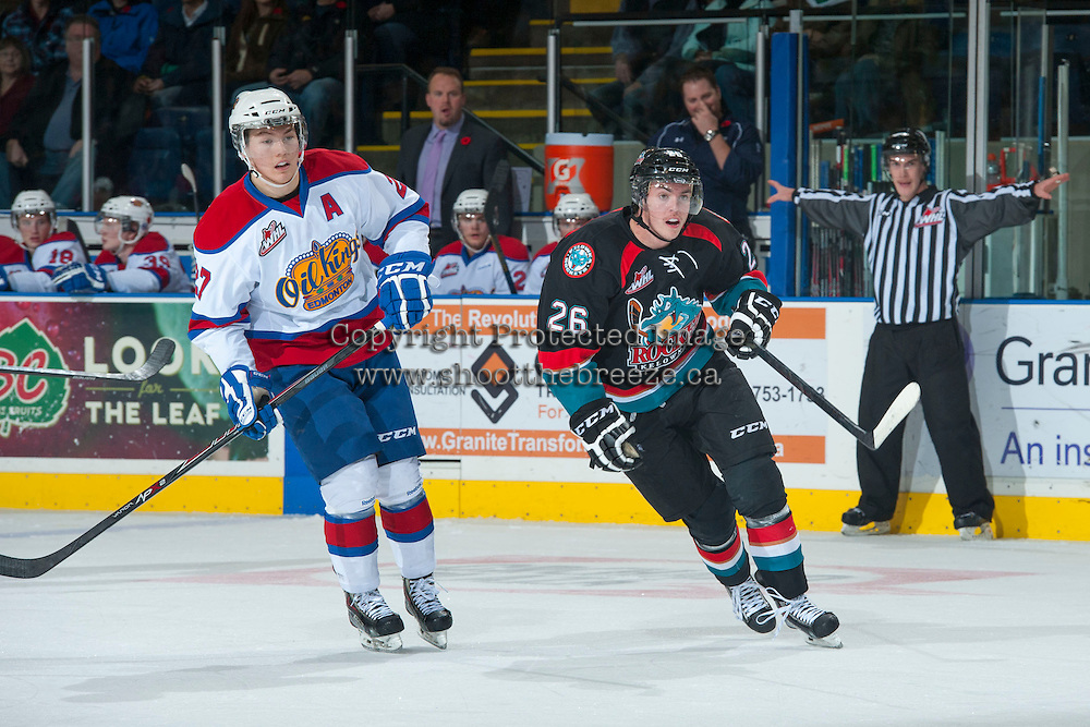 KELOWNA, CANADA - NOVEMBER 9: Cole Linaker #26 of the Kelowna Rockets is checked by Curtis Lazar #27 of the Edmonton OIl Kings on November 9, 2013 at Prospera Place in Kelowna, British Columbia, Canada.   (Photo by Marissa Baecker/Shoot the Breeze)  ***  Local Caption  ***