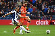 West Bromwich Albion forward Jay Rodriguez (19) plays a pass away from Millwall midfielder Shaun Williams (6) during the EFL Sky Bet Championship match between West Bromwich Albion and Millwall at The Hawthorns, West Bromwich, England on 22 September 2018.