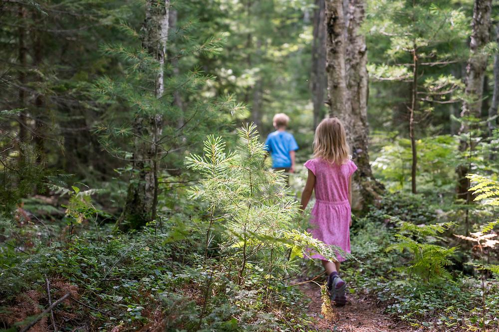 Hiking along the White Birch Trail at Pictured Rocks National Lakeshore near Munising, Michigan.
