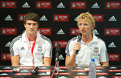 SINGAPORE, SINGAPORE - Sunday, July 17, 2011: Liverpool's Martin Kelly and Dirk Kuyt during an Adidas sponsored event at the Adidas store in the Marina Bay Sands Shopping Centre on day seven of the club's preseason Asia Tour. (Photo by David Rawcliffe/Propaganda)