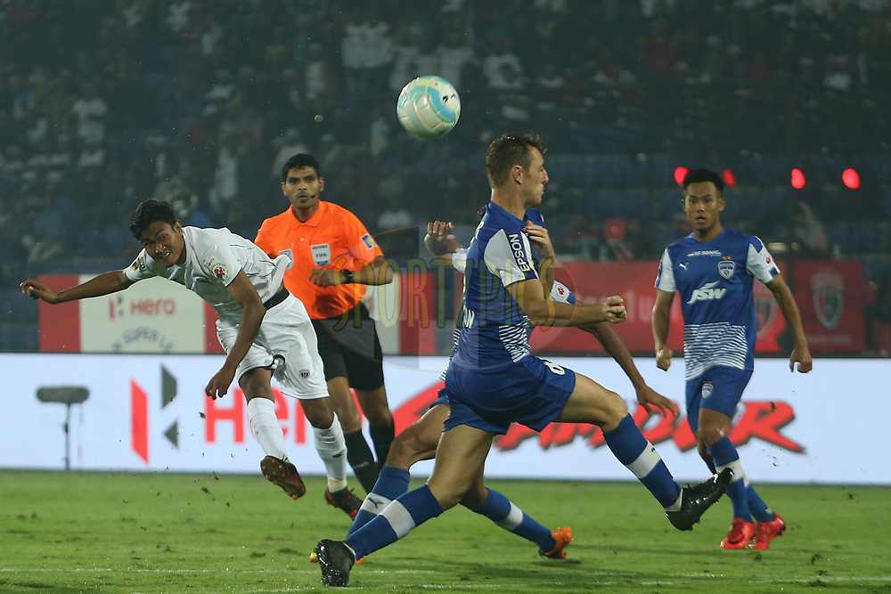 Hali Charan Narzary of Northeast United FC shoots during match 19 of the Hero Indian Super League between NorthEast United FC and Bengaluru FC held at the Indira Gandhi Athletic Stadium, Guwahati India on the 8th December 2017<br /> <br /> Photo by: Ron Gaunt / ISL / SPORTZPICS
