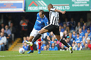 Brett Pitman is challenged by Reece Brown during the EFL Sky Bet League 1 match between Portsmouth and Rochdale at Fratton Park, Portsmouth, England on 5 August 2017. Photo by Daniel Youngs.