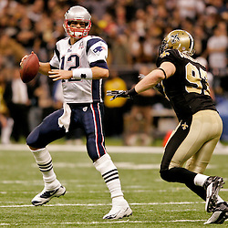 2009 November 30:  New Orleans Saints defensive end Jeff Charleston (97) pressures New England Patriots quarterback Tom Brady (12) to throw during the second half of a 38-17 win by the New Orleans Saints over the New England Patriots at the Louisiana Superdome in New Orleans, Louisiana.