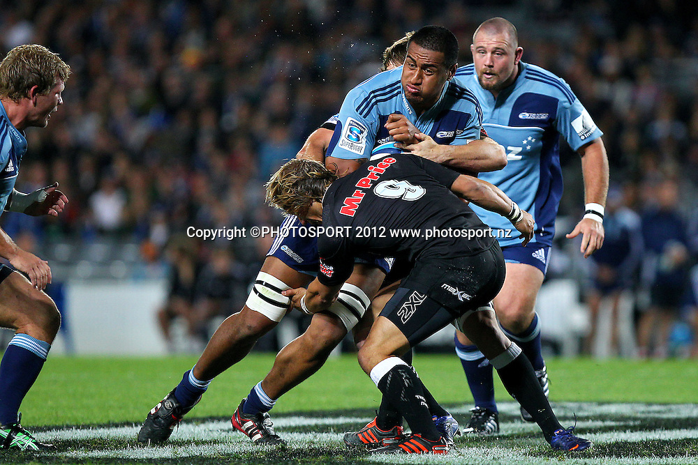 Blues' Filo Paulo charges into Sharks' Charl McLeod. Super Rugby rugby union match, Blues v Sharks at Eden Park, Auckland, New Zealand. Friday 13th April 2012. Photo: Anthony Au-Yeung / photosport.co.nz