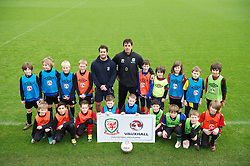 CARDIFF, WALES - Thursday, January 31, 2013: Wales' manager Chris Coleman helps launch Vauxhall's Fun Football programme with the Football Association of Wales and the Welsh Football Trust at the Vale of Glamorgan Hotel. (Pic by David Rawcliffe/Propaganda)