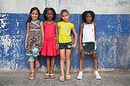 CUBA: Havana. children and girls fashion , deux par deux collection . Havana CITY center.  old american cars , vintage, in Monte street     / Cuba. La Havane.  mode enfants, collection - deux par deux - La Havane centro, vielles voitures americaines dans la rue monte    D5Cuba,
