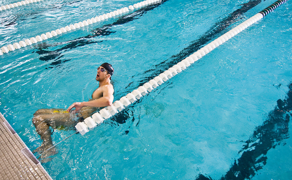 Freelance photo by Matt Roth.Baltimore, Maryland.Thursday, May 7, 2009.Assignment ID: 20102758A..Michael Phelps takes a pause during practice to talk to his coach Bob Bowman.