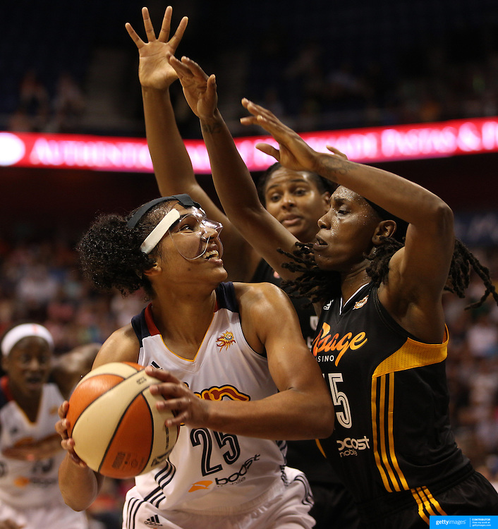 Alyssa Thomas, (left), Connecticut Sun, playing with a face mask to protect her injured nose, drives to the basket protected by Roneeka Hodges, Tulsa Shock, during the Connecticut Sun Vs Tulsa Shock WNBA regular season game at Mohegan Sun Arena, Uncasville, Connecticut, USA. 3rd July 2014. Photo Tim Clayton