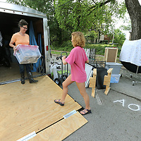 """Michele LzMachio, left, of Olive Branch and her helper, Hannah Smith of Memphis begin unpacking their trailer full of art for LaMachio's booth """"Air Artsy Accesories"""" at the Gumtree Festival on Friday."""
