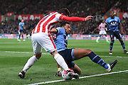 Tottenham Hotspur midfielder Mousa Dembele (19)  blocks the cross from Stoke City forward Bojan Krkic (27)  during the Barclays Premier League match between Stoke City and Tottenham Hotspur at the Britannia Stadium, Stoke-on-Trent, England on 18 April 2016. Photo by Simon Davies.
