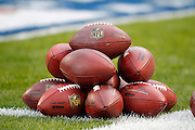 A stack of footballs sits on the grass during pregame warmups at the Pittsburgh Steelers NFL week 16 football game against the St. Louis Rams on Saturday, December 24, 2011 in Pittsburgh, Pennsylvania. The Steelers won the game in a 27-0 shutout. ©Paul Anthony Spinelli