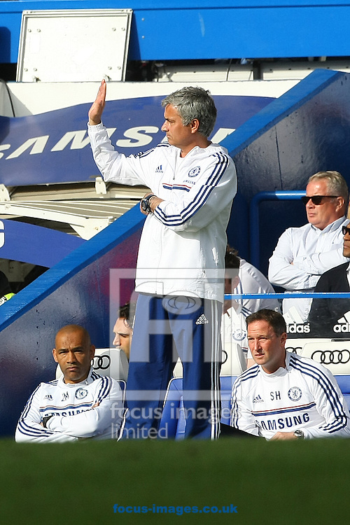 Chelsea Manager Jose Mourinho waves to the fans as they sing his name during the Barclays Premier League match at Stamford Bridge, London<br /> Picture by Paul Chesterton/Focus Images Ltd +44 7904 640267<br /> 04/05/2014