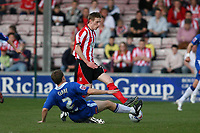 Photo: Pete Lorence.<br />Lincoln City v Stockport County. Coca Cola League 2. 07/04/2007.<br />Robert Clare tackles Jeff Hughes.