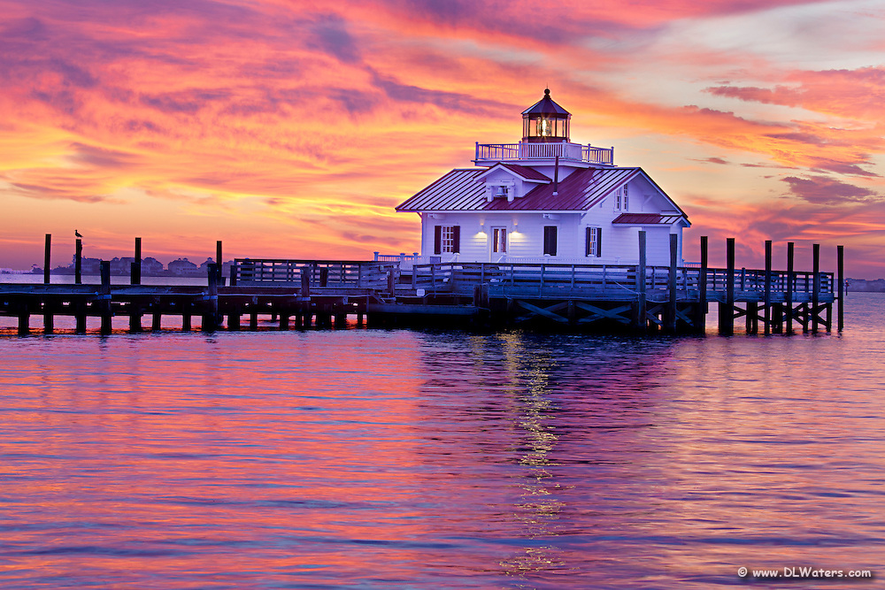 A fabulous sunrise at Roanoke Marshes Lighthouse on Shallow Bag Bay in Manteo North Carolina.