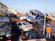 April 2, 2014 - Iquique, Chile - <br /> <br /> 8.2 Earthquake Hits Chile's Northern Coast<br /> <br /> Damaged cars and boats are seen at a dock after an earthquake in Iquique of Tarapaca Region, north of Chile. An 8.2-magnitude earthquake hit off the northern coast of Chile Tuesday, leaving 6 people dead while thousands of people have been evacuated due to a tsunami alert.<br /> ©Exclusivepix
