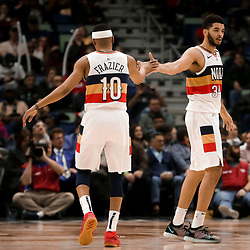 Jan 30, 2019; New Orleans, LA, USA; New Orleans Pelicans guard Kenrich Williams (34) and guard Tim Frazier (10) react after a three point basket during the second half against the Denver Nuggets at the Smoothie King Center. Mandatory Credit: Derick E. Hingle-USA TODAY Sports