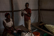 KYANGWALI REFUGEE CAMP, UGANDA - MARCH 23: An MSF staff member changes an IV at a cholera treatment center in Kyangwali refugee resettlement camp in Uganda on March 23, 2018. Cholera is endemic in Eastern Congo and many of the refugees bring the disease to the camp. Violence in Ituri Province in northeastern Democratic Republic of Congo has displaced more than 100,000 people including approximately 40,000 refugees who have fled to Uganda. (Photo by Andrew Renneisen for The Washington Post)