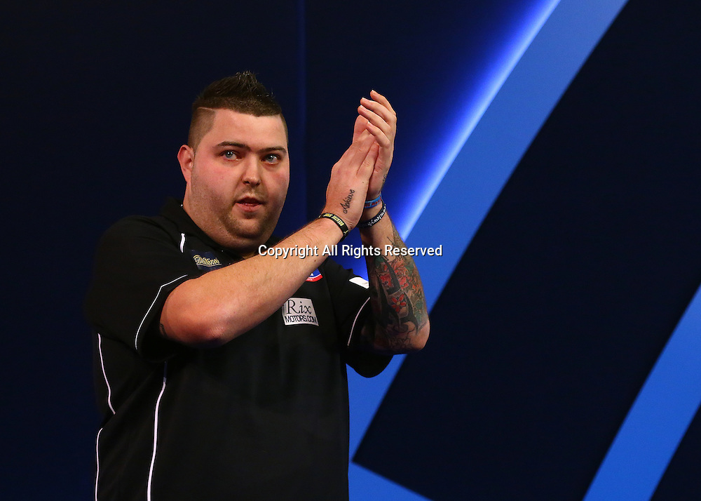23.12.2016. Alexandra Palace, London, England. William Hill PDC World Darts Championship. Michael Smith applauds his fans, as he makes the walk to the Oche, for his match with Mervyn King