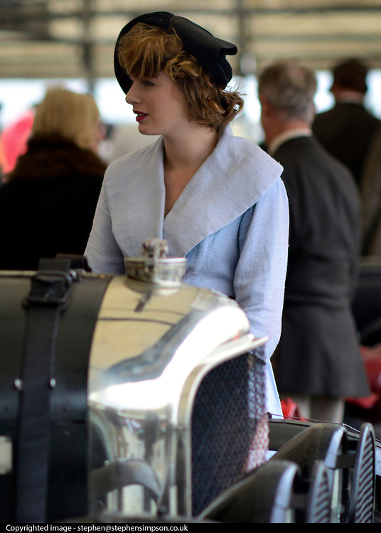 © Licensed to London News Pictures. 14/09/2012. Goodwood, UK People enjoy the atmosphere at the 2012 Goodwood Revival Meeting today 14 September 2012. Participants are encouraged to dress in period dress.. Photo credit : Stephen Simpson/LNP