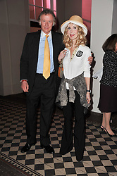 RICHARD & BASIA BRIGGS at a fashion show by Catherine Walker & Co in support of The Haven held at One Mayfair, North Audley Street, London on 18th May 2011.