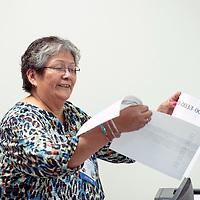 Passing out papers, Fern Spencer has provided 45 years of service for students who competed in the Business Professionals of America in Albuquerque Feb. 14, 2019.