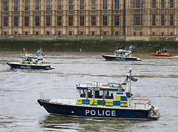 Westminster, London, March 29th 2017. One week after the terror attack on Westminster bridge, it is once again the scene of an emergency services operation as police, ambulance and fire crews search the river after a person jumped from the bridge. The person has not so far been recovered.<br /> PICTURED:  Police boats scour the river.<br /> CREDIT: ©Paul Davey<br /> FOR LICENCING CONTACT: Paul Davey +44 (0) 7966 016 296 paul@pauldaveycreative.co.uk