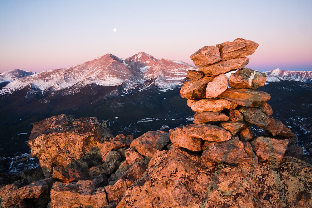 Moon over Longs Peak at sunrise, from Twin Sisters Mountain, Rocky Mountain National Park, Colorado.
