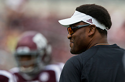 Texas A&M head coach Kevin Sumlin watches his team warmup before the start of an NCAA college football game against Louisiana-Lafayette Saturday, Sept. 16, 2017, in College Station, Texas. (AP Photo/Sam Craft)