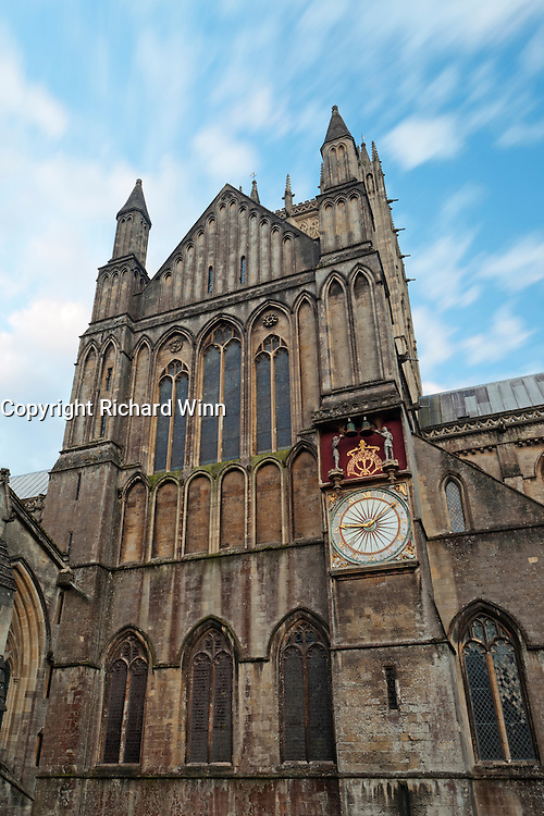 Long exposure showing clouds flowing above Wells Cathedral, also showing the clock.
