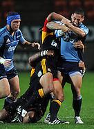 Luke McAlister gets tackled. Investec Super Rugby - Chiefs v Blues, Waikato Stadium, Hamilton, New Zealand. Saturday 26 March 2011. Photo: Andrew Cornaga / photosport.co.nz