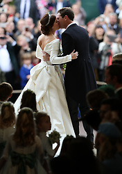 Princess Eugenie and her new husband Jack Brooksbank kiss as they leave St George's Chapel in Windsor Castle following tehir wedding.