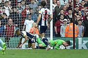 West Bromwich Albion striker (on loan from Newcastle United) Dwight Gayle (16) fouls Aston Villa goalkeeper Jed Steer (12) and is sent off during the EFL Sky Bet Championship first leg Play Off match between Aston Villa and West Bromwich Albion at Villa Park, Birmingham, England on 11 May 2019.