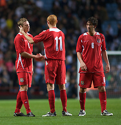 BIRMINGHAM, ENGLAND - Monday, October 13, 2008: Wales' Simon Church and Shaun MacDonald look dejected after losing to England during the UEFA European Under-21 Championship Play-Off 2nd Leg match at Villa Park. (Photo by Gareth Davies/Propaganda)