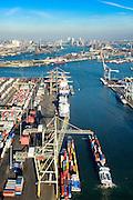 Nederland, Zuid-Holland, Rotterdam, 18-02-2015. Waalhaven Westzijde, Uniport. Containerterminals en containeroverslag. Zicht op Waalhaven Noord en Charlois, skyline Rotterdam aan de horizon.<br /> Container storage and transshipment Waalhaven (Waal harbour) of the Port of Rotterdam.<br /> luchtfoto (toeslag op standard tarieven);<br /> aerial photo (additional fee required);<br /> copyright foto/photo Siebe Swart