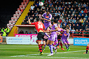 Plymouth Argyle's Jamille Matt heads the ball out of danger during the Sky Bet League 2 match between Exeter City and Plymouth Argyle at St James' Park, Exeter, England on 2 April 2016. Photo by Graham Hunt.