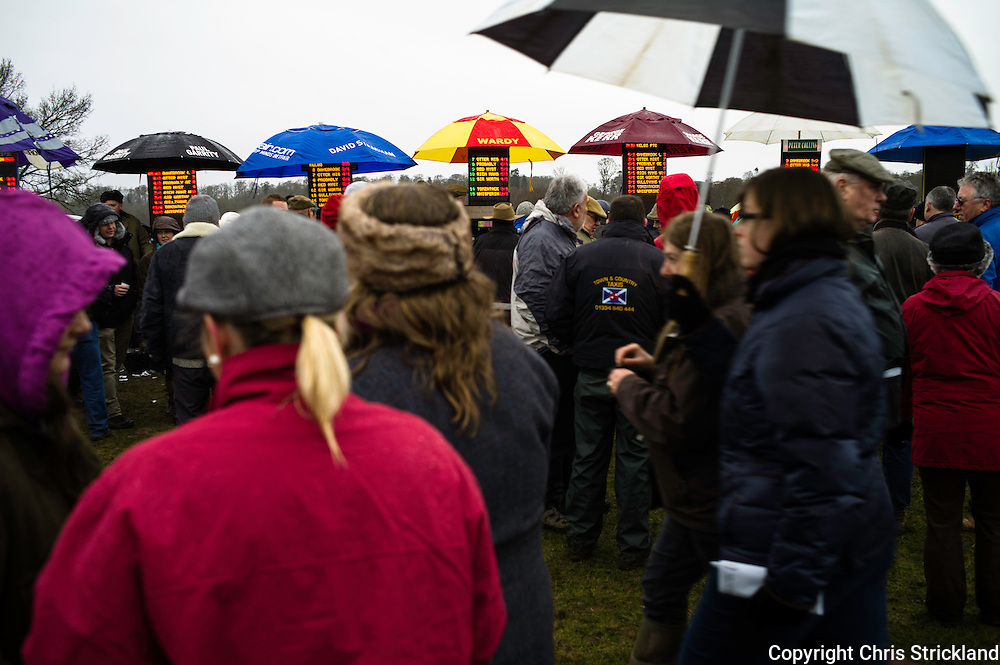Punters weigh up the odds and place bets during a race meet in the Scottish Borders town of Kelso.